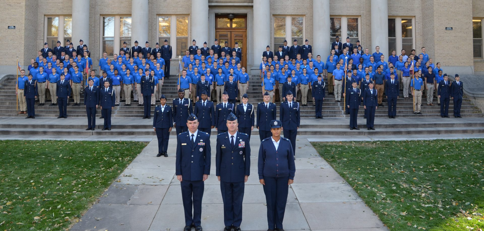 200 cadets in formation with three officers in front, all in service dress