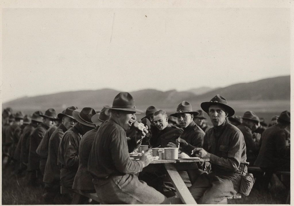 Old picture of military camp eating