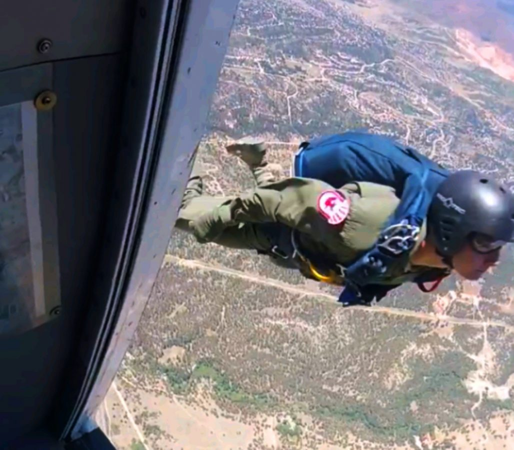 Cadet skydiving out of an airplane