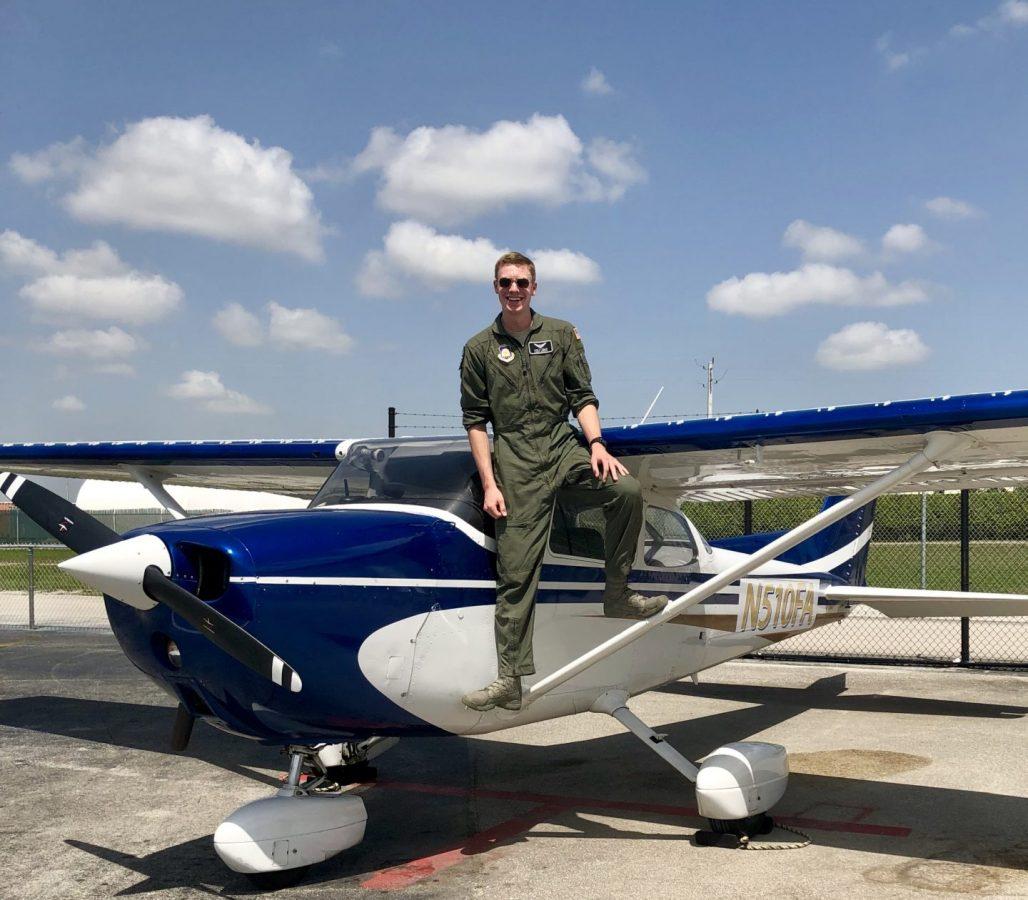 Cadet standing on a civilian aircraft after a flight